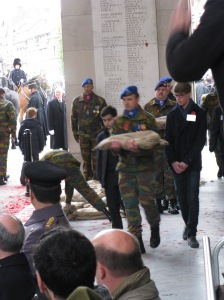 Schoolboys escorting the soldier carrying Flanders Fields soil